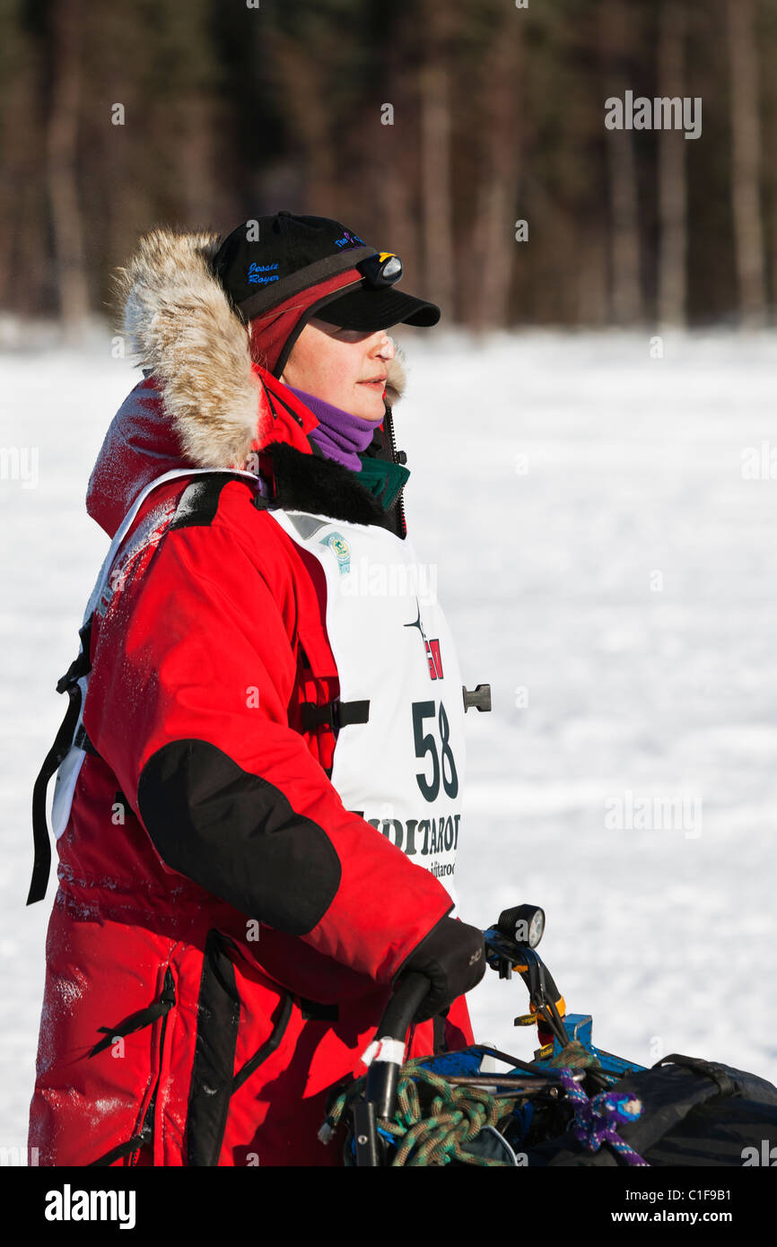 Musher Jessie Royer competing in the 39th Iditarod Trail Sled Dog Race on Long Lake after leaving Willow Lake restart. - Stock Image