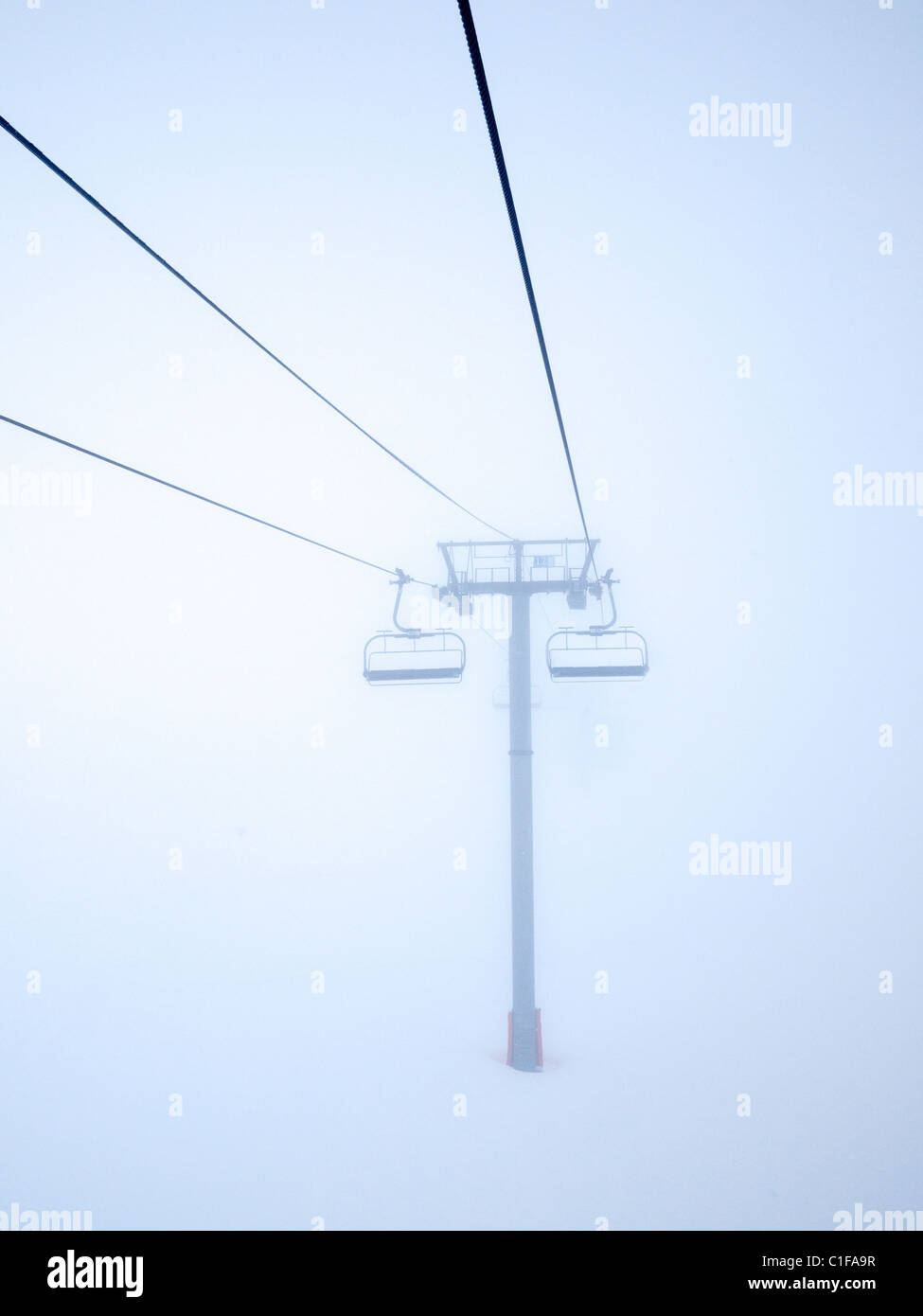 Empty ski chairlifts in blizzard Stock Photo
