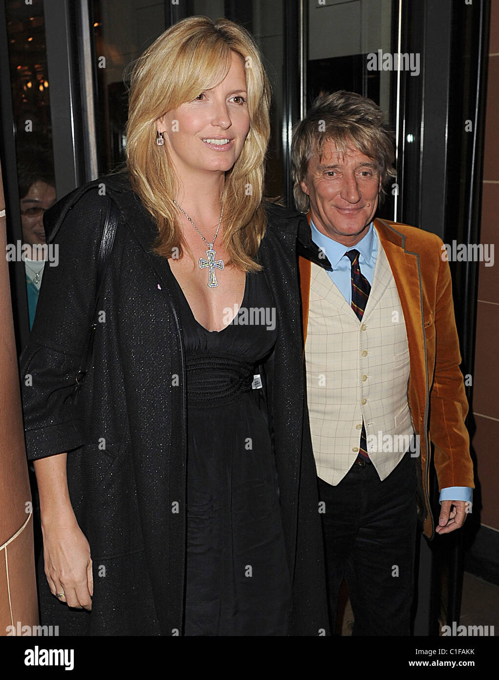 25db2382cc68 Penny Lancaster wearing a large silver cross necklace leaves Ciprani  Restaurant with husband Rod Stewart. Rod refused to sign
