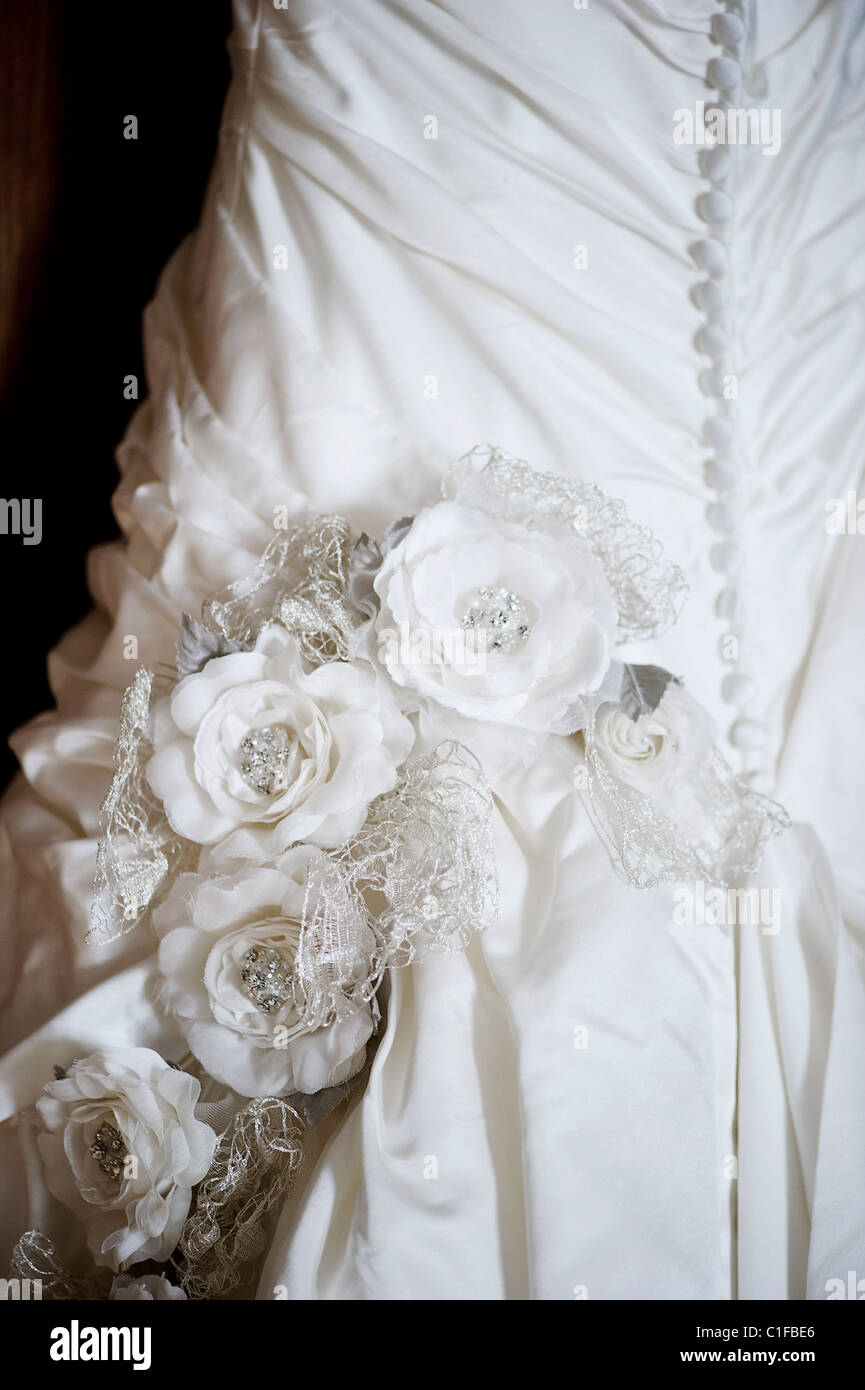 Close Up Of Part Of Wedding Dress Silk Flowers Buttons And Corset