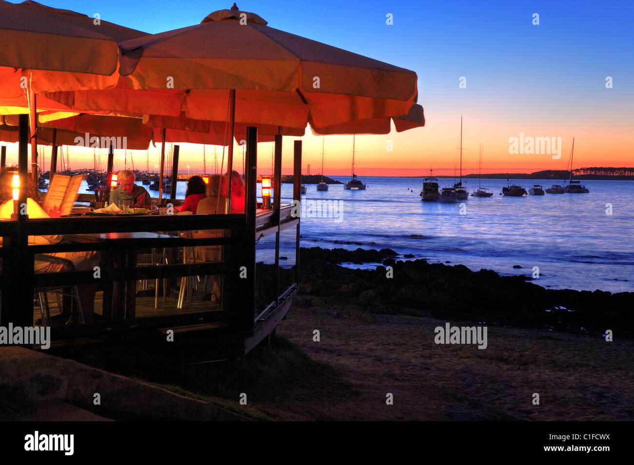 Bar and yatchs at Punta del Este coast, at sunset. Maldonado, Uruguay, south america - Stock Image