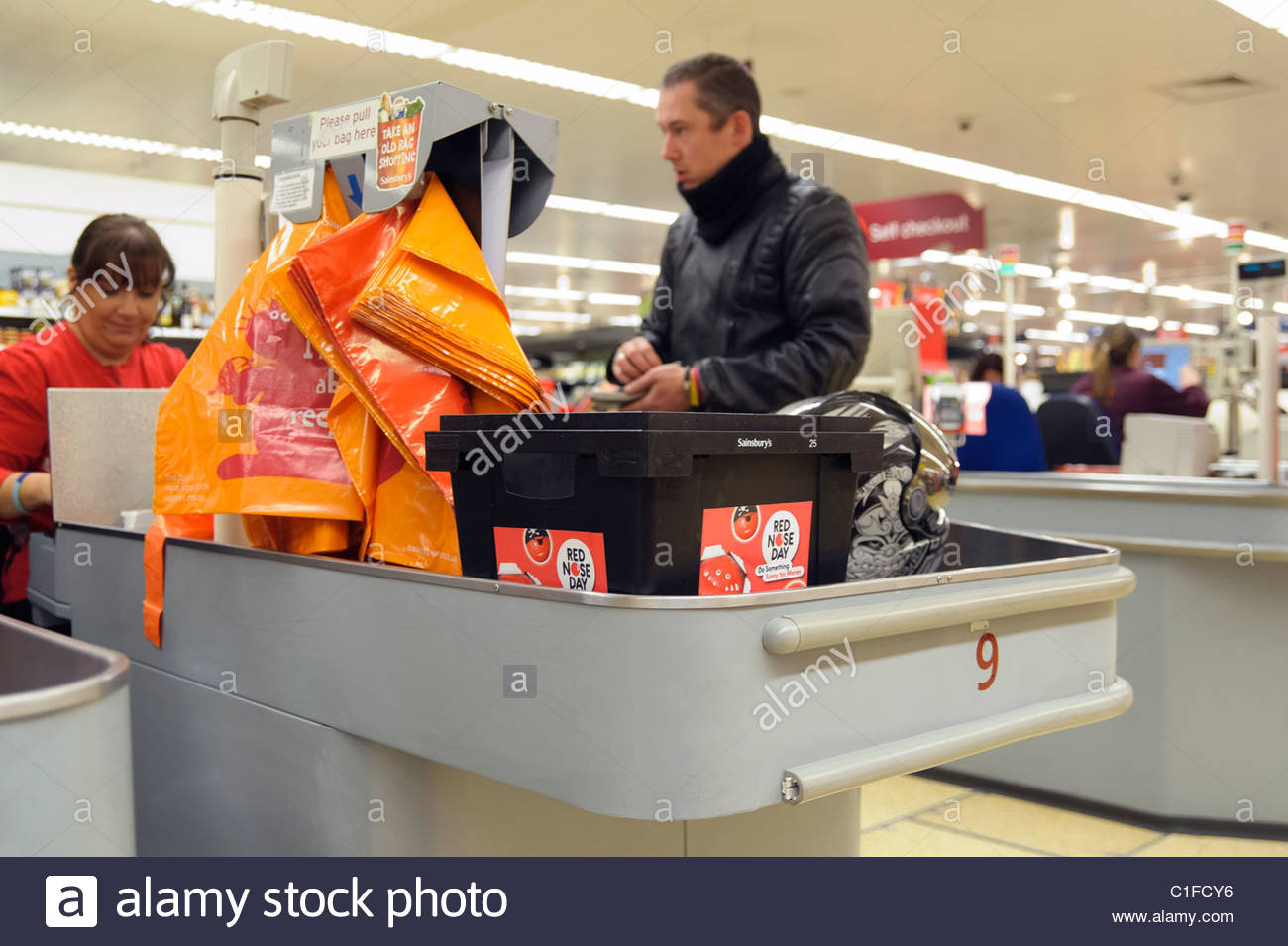 Red nose day charity collection box at a Sainsburys