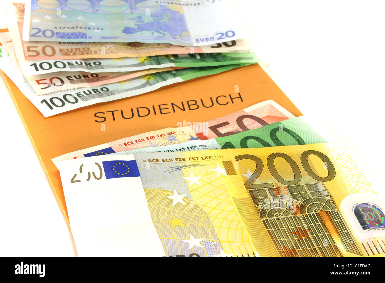 purchased diploma - Study book with lots of euro notes - Stock Image