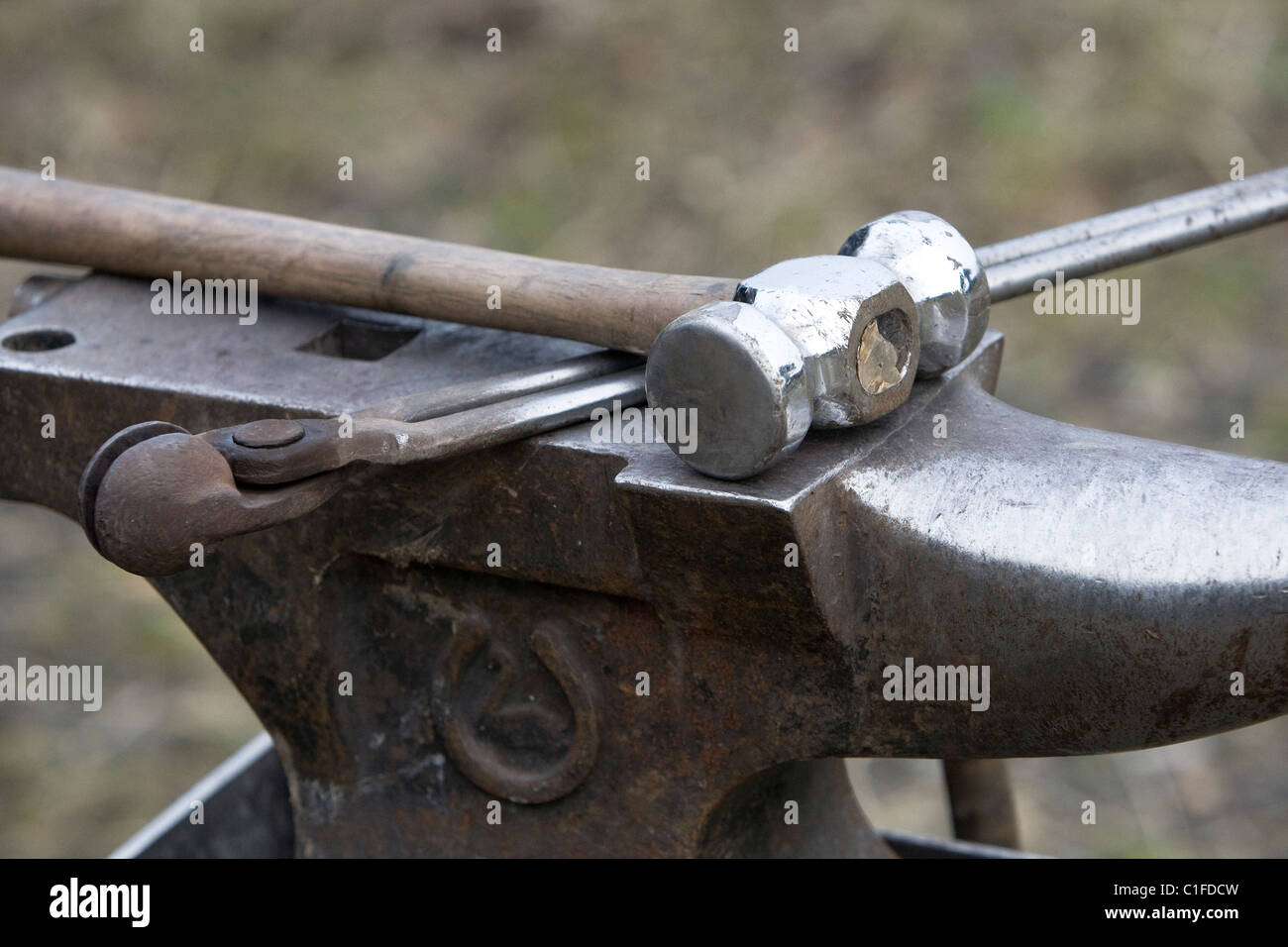 Mobile farriers anvil, hammer and tongs. - Stock Image