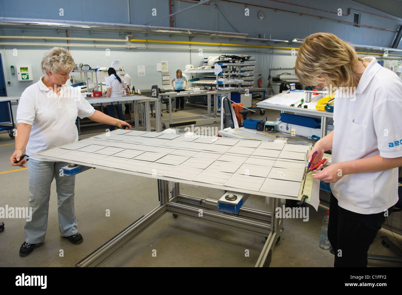 Quality control and connection of contacts, Prenzlau, Germany - Stock Image