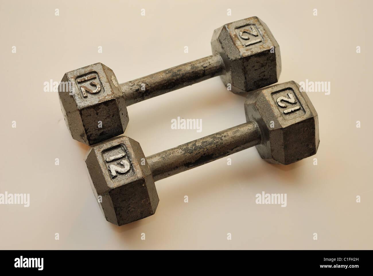 12 pound dumbbells - Stock Image