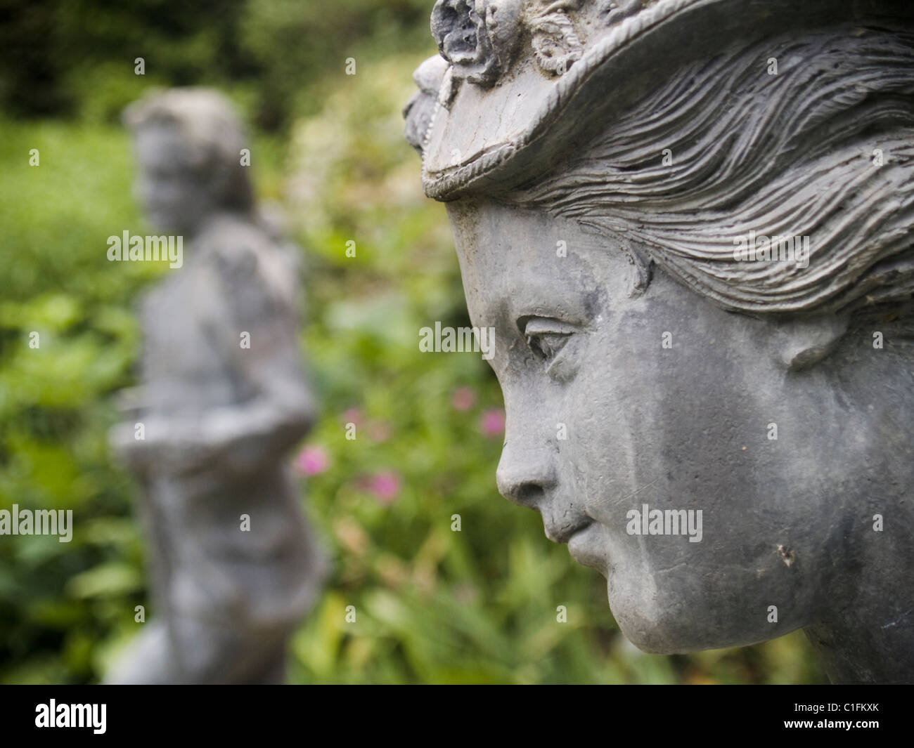Statues In A Traditional English Garden   Stock Image