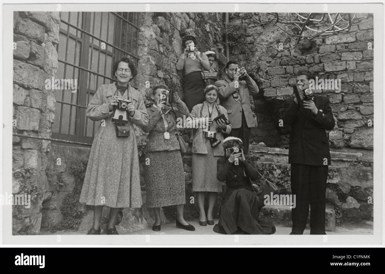 Postcard of Camera Club members taking photographs of a tourist site in Sicily, Italy  - circa 1940's  1950's, - Stock Image