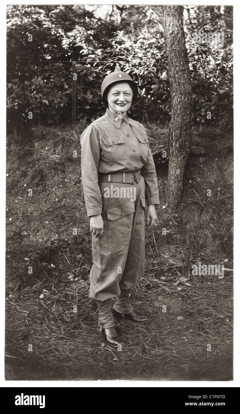 Smiling young woman wearing her American soldier boyfriend's army uniform, probably during WW2 (WWii) - Stock Image
