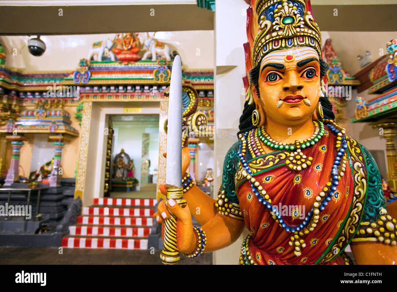 Hindu guardian at the Sri Mariamman Temple.  Chinatown, Singapore - Stock Image