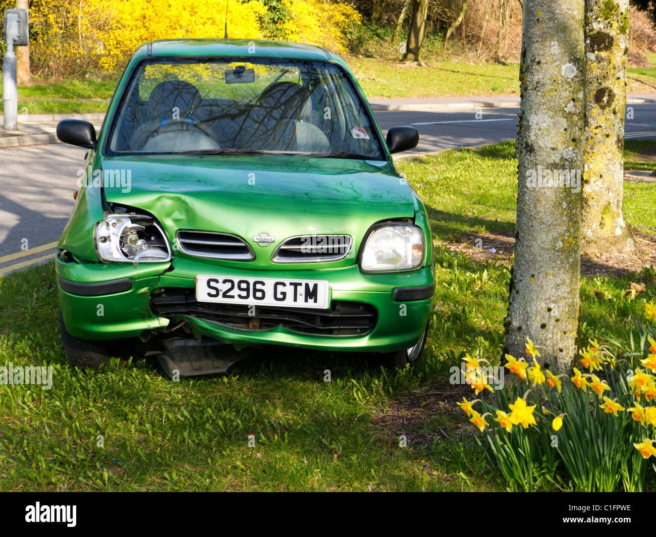 Small green Nissan Micra car after frontal crash into tree on rural ...