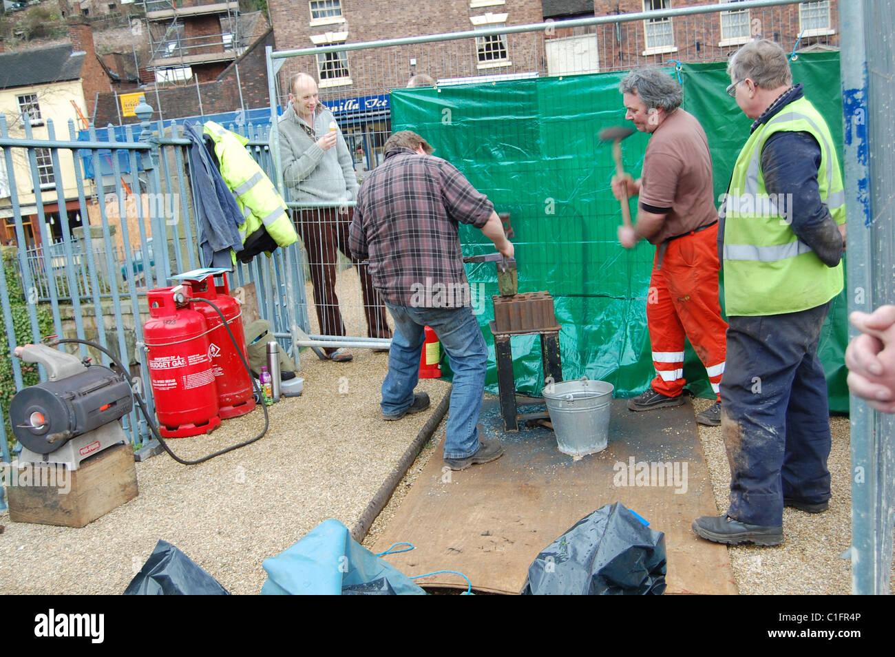 men at work in ironbridge, england - Stock Image