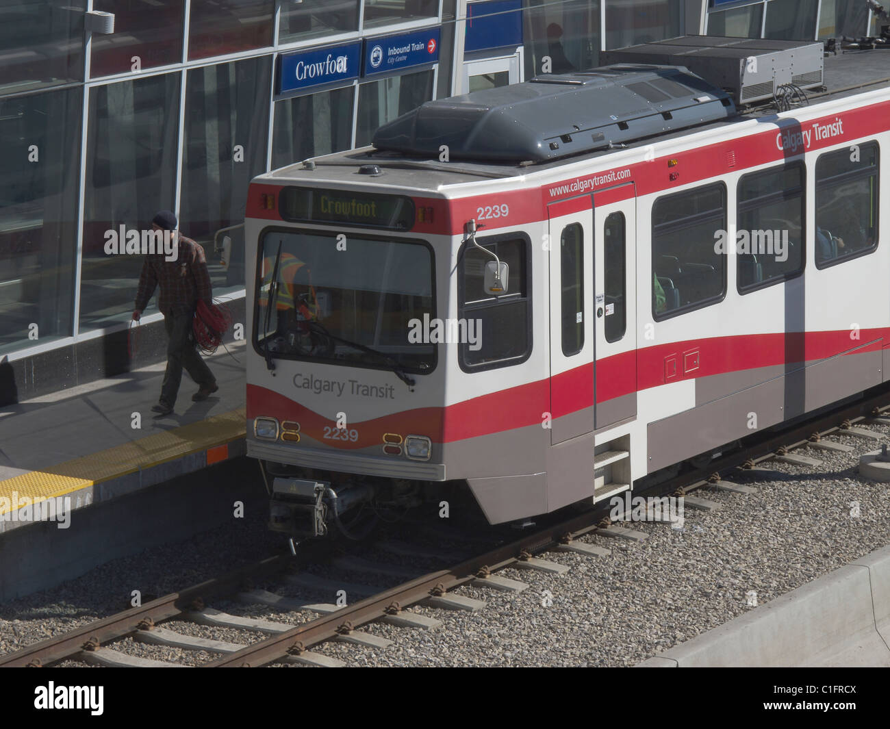 Man walking off Calgary C-Train at the Crowfoot LRT station in NW Calgary Alberta Canada - Stock Image