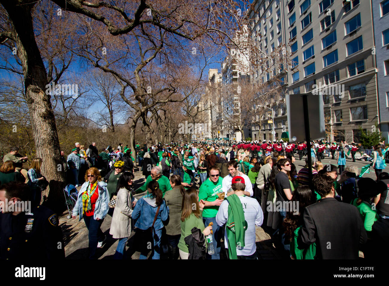 Thousands gather on Fifth Avenue to watch the 250th annual St. Patrick's Day parade in New York City - Stock Image