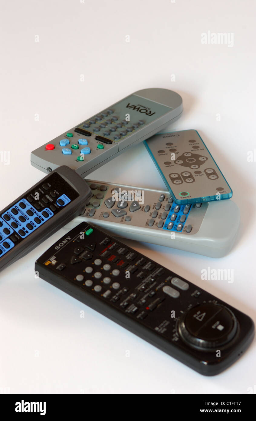 Assorted remote controls for television, dvd's and sterio systems - Stock Image