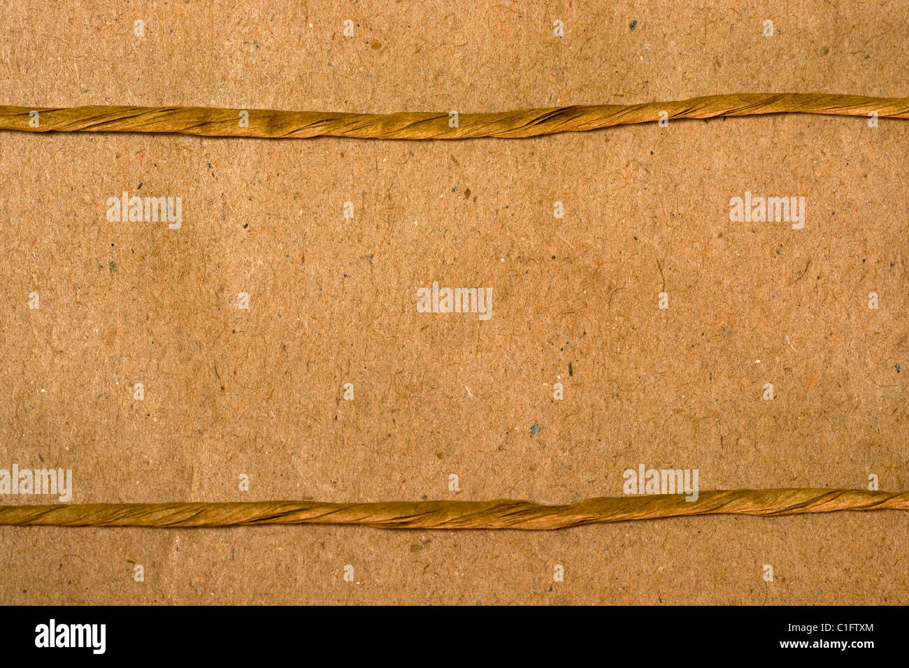 Two ropes parallel on a paper background - Stock Image