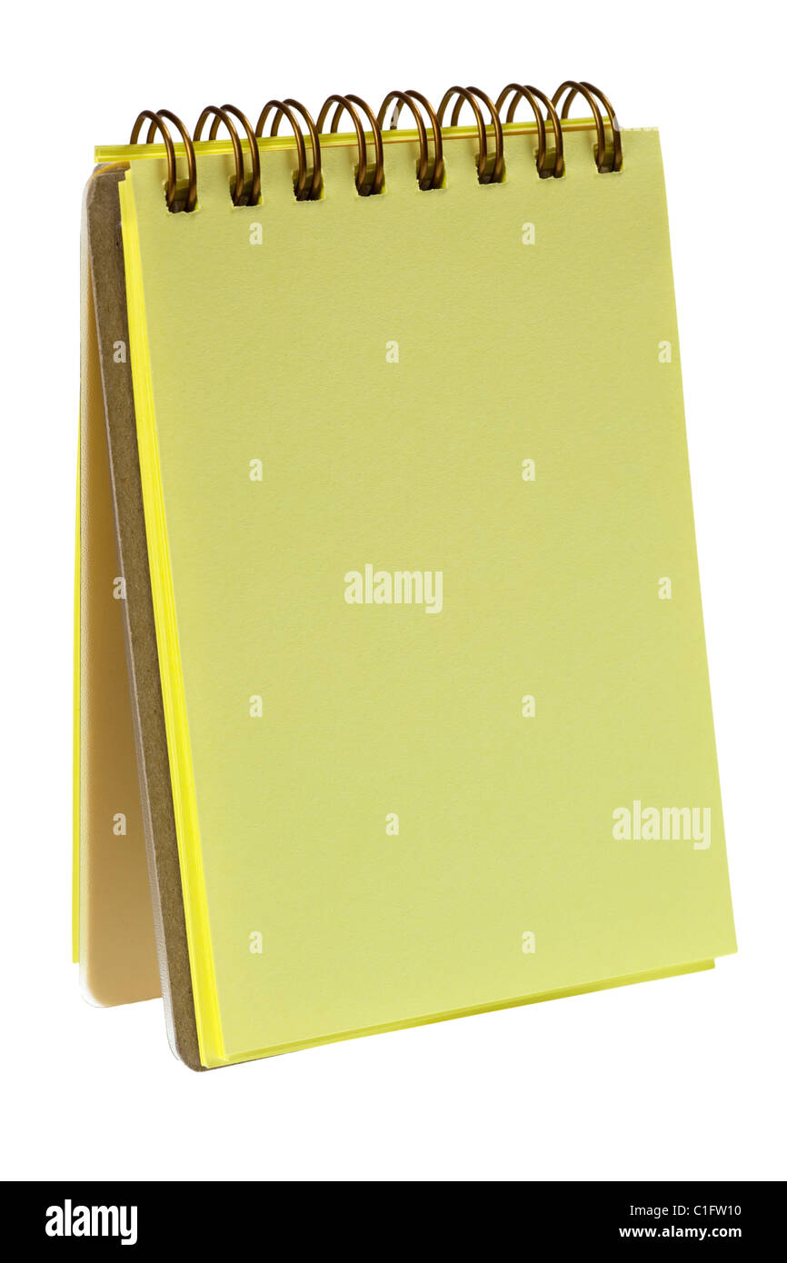Yellow colored notepad isolated on white background - Stock Image