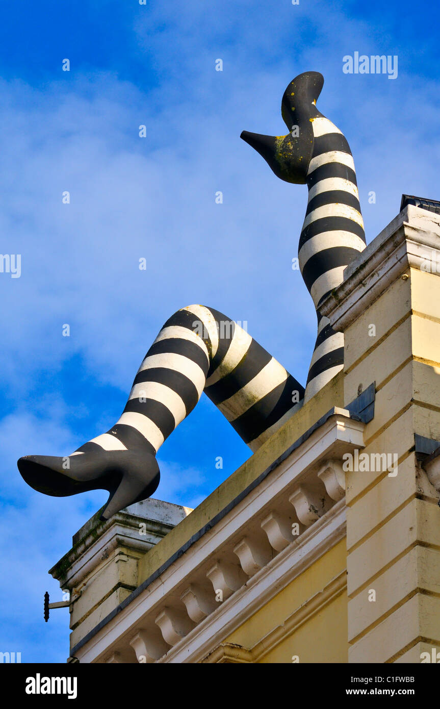 Giant 'Can Can' legs sculpture on the roof of Duke of Yorks art house cinema, Brighton, East Sussex, UK - Stock Image