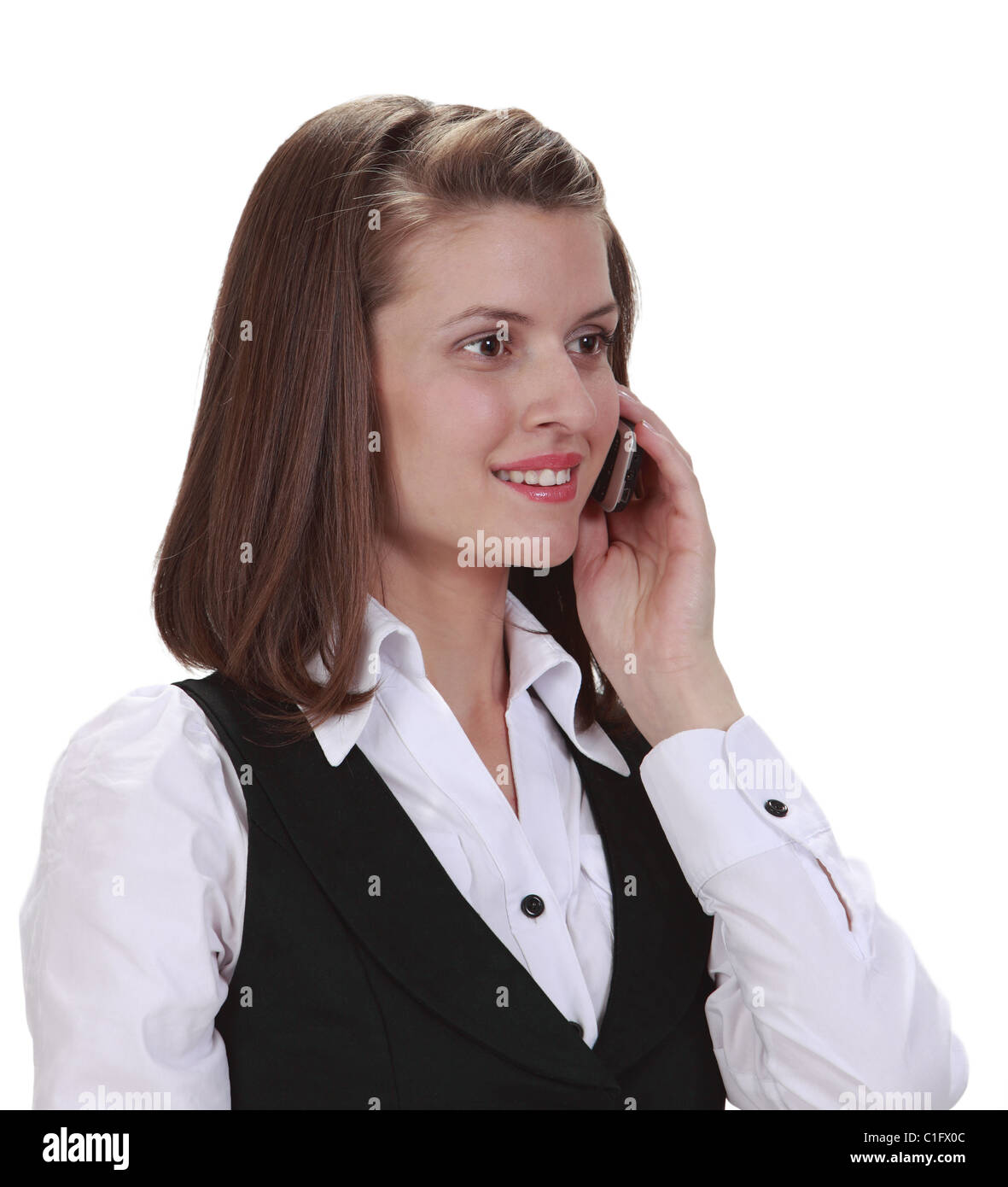 Portrait of a young woman on the phone, isolated against a white background. - Stock Image
