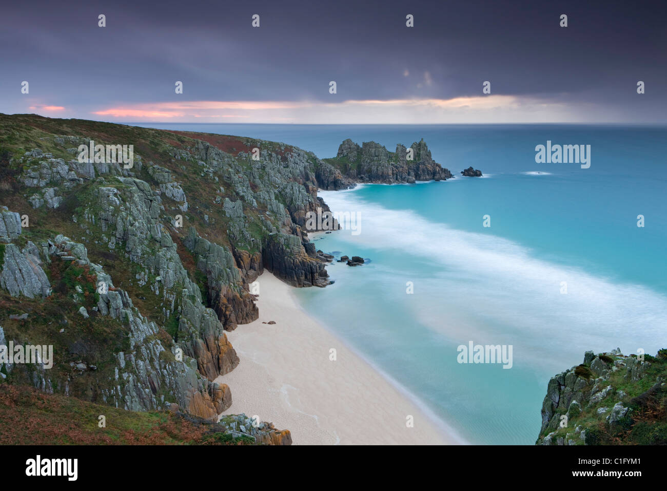 Pednvounder Beach and Logan Rock from Treen Cliff, Porthcurno, Cornwall, England. Autumn (October) 2010. - Stock Image