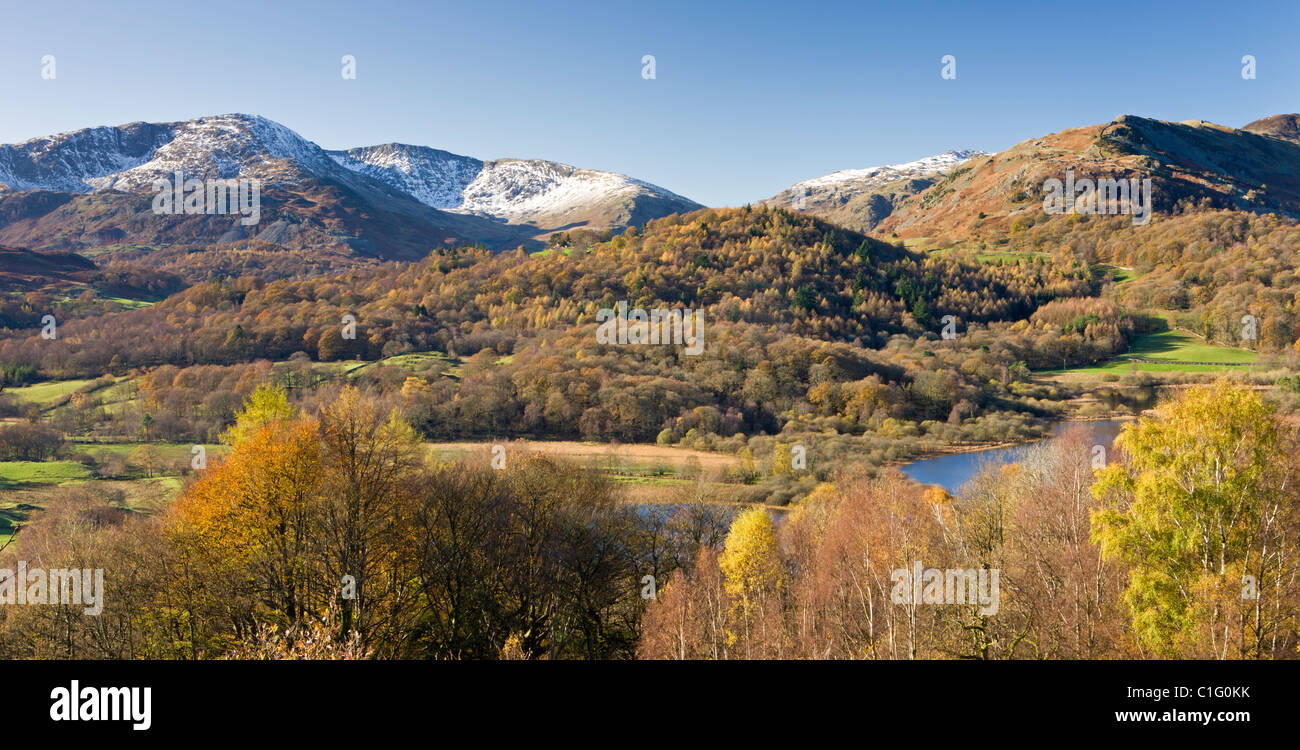 Elterwater, the Langdale valley and snow capped mountains from Crag Head, Lake District National Park, Cumbria, - Stock Image