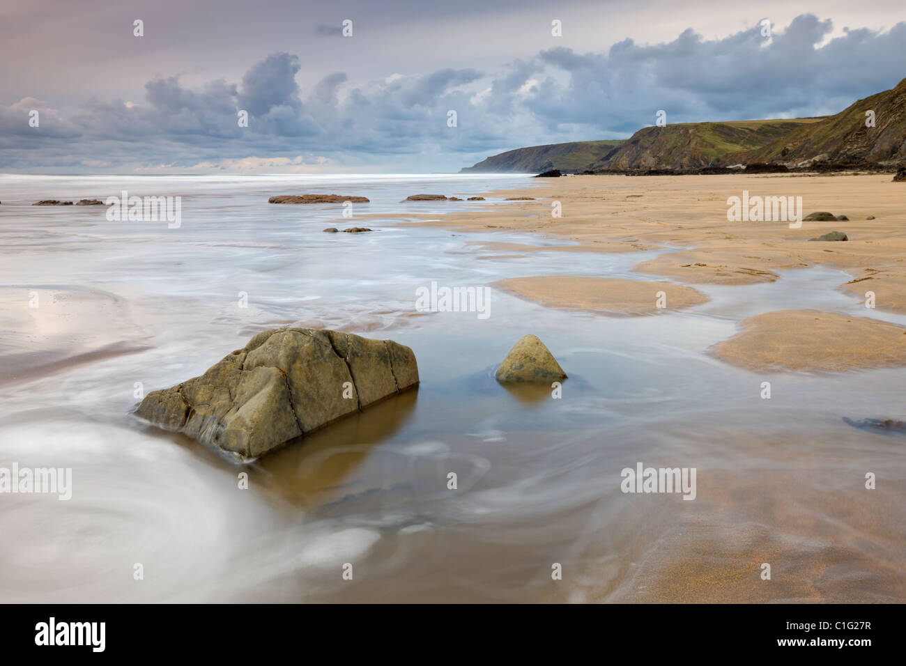 Incoming tide on Sandymouth Beach, Cornwall, England. Autumn (November) 2010. - Stock Image
