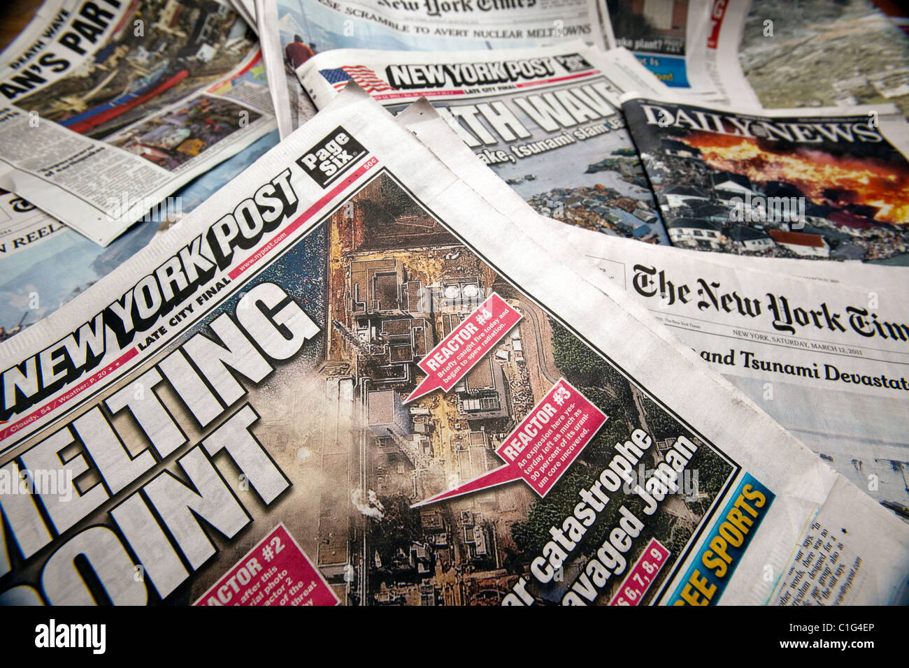 Headlines of New York newspapers report the ongoing nuclear crisis in Japan. - Stock Image