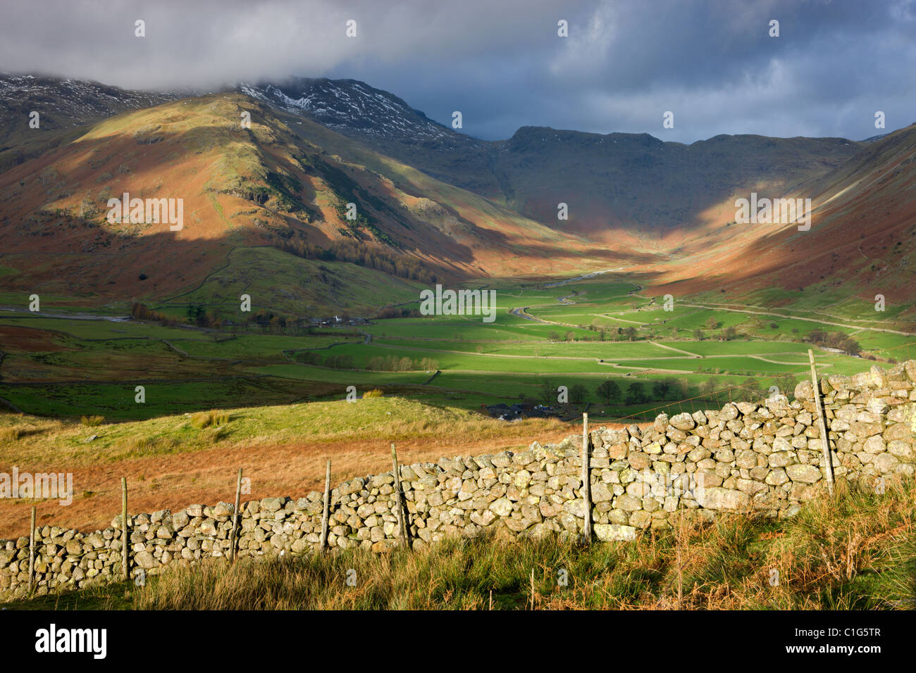 Morning sunlight in the Mickleden Valley and on the Langdale Fell, Lake District National Park, Cumbria, England. - Stock Image