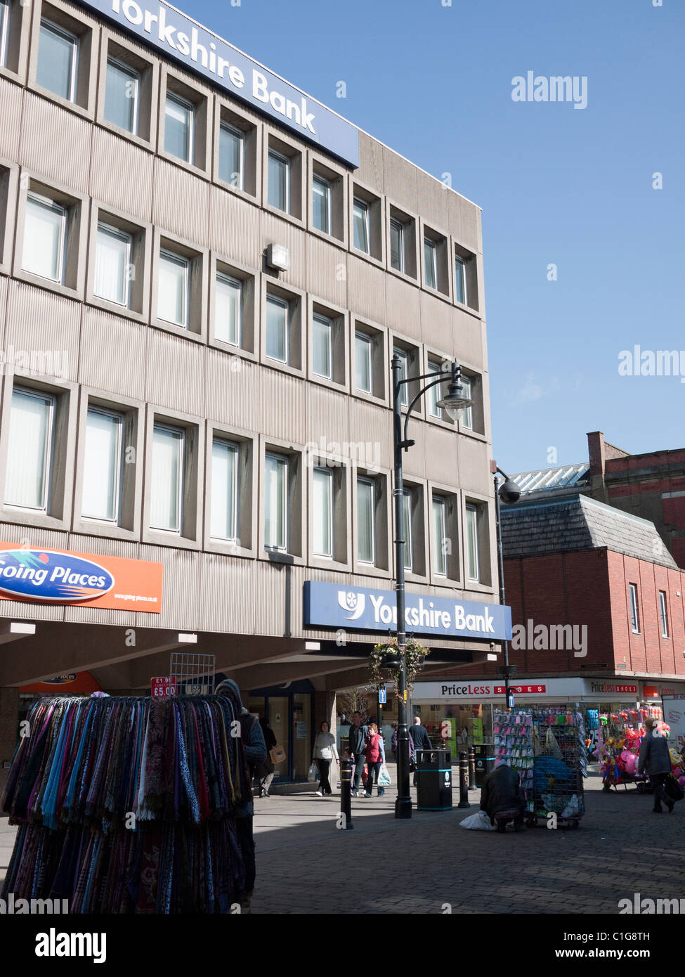 Yorkshire Bank and street sellers Oldham Town Centre, Lancashire, England, UK. - Stock Image