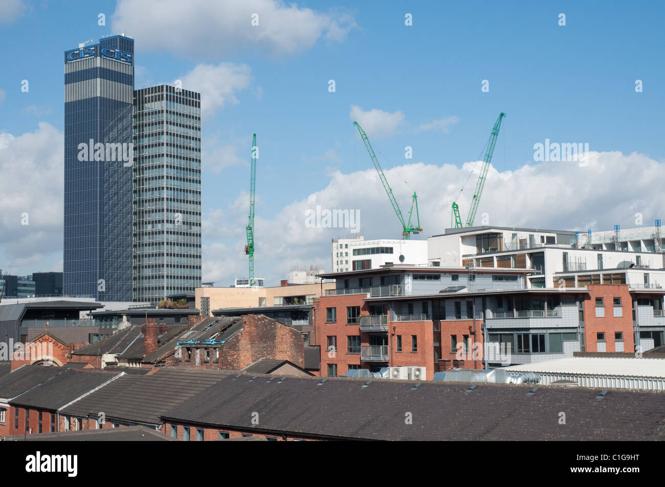 City centre Manchester, old property in the foreground new apartments and the CIS building. - Stock Image