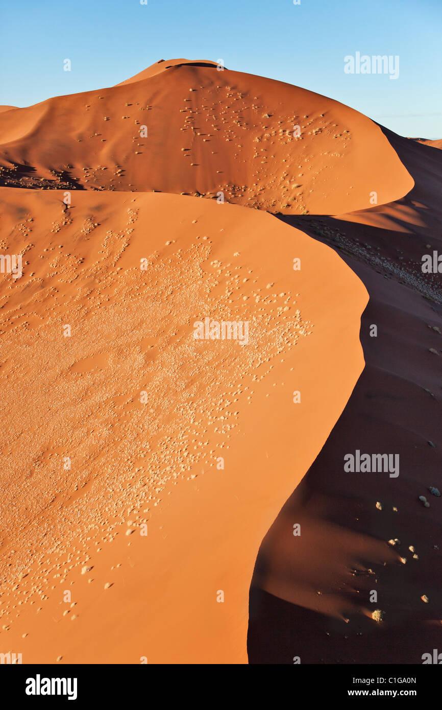 Aerial view of red sand dunes at Sossusvlei. Namib desert. Namib-Naukluft N.P, Namibia - Stock Image
