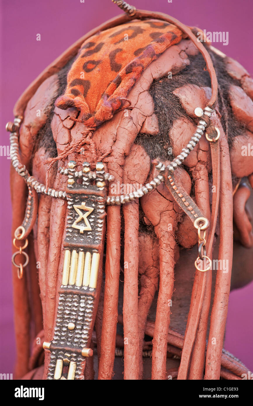 dreadlocks worn by Himba woman in traditional dress who live in the Kunene Region, Namibia Stock Photo