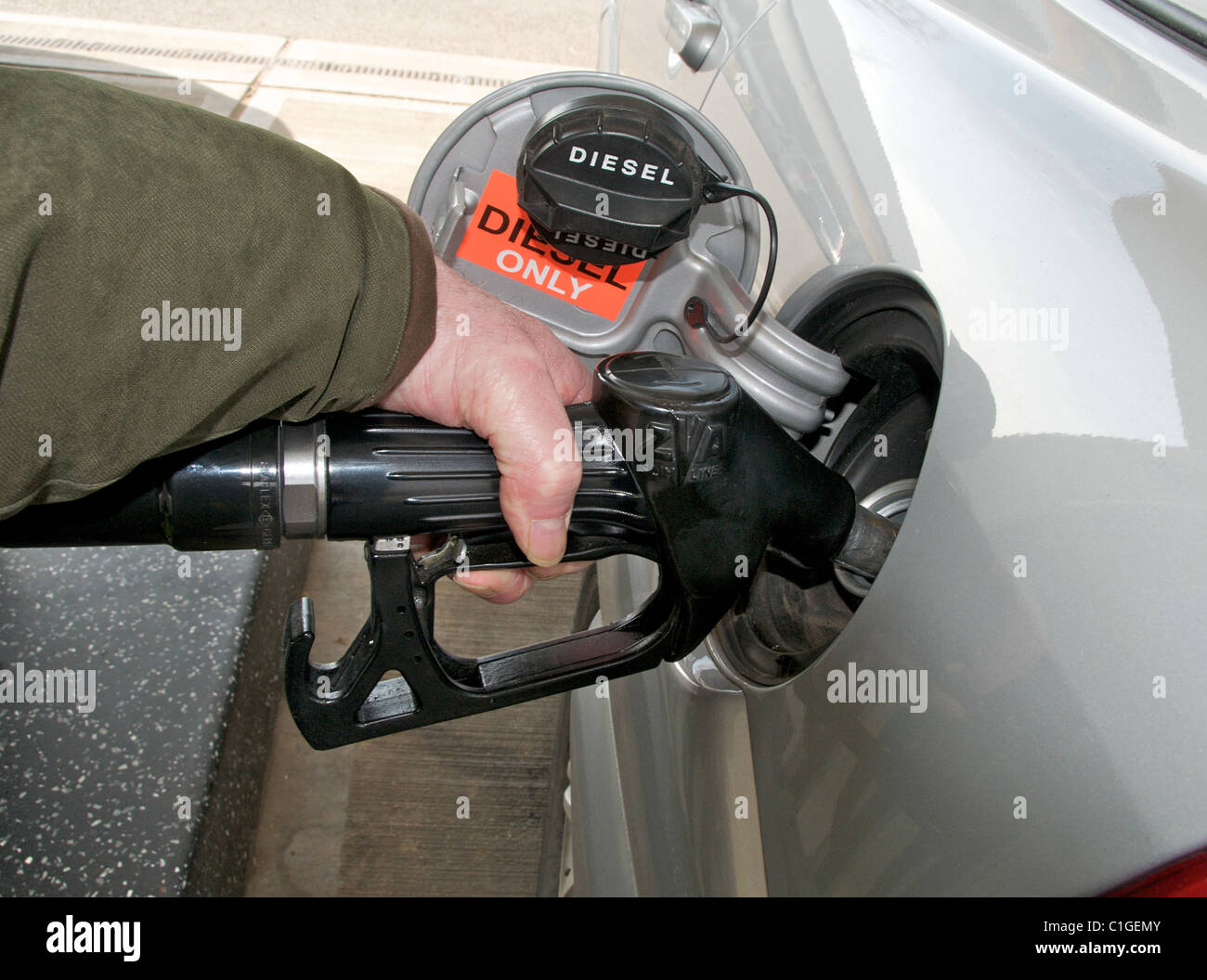 Images of fuel petrol diesel pumps nozzles on forecourt of garage filling station in UK Stock Photo
