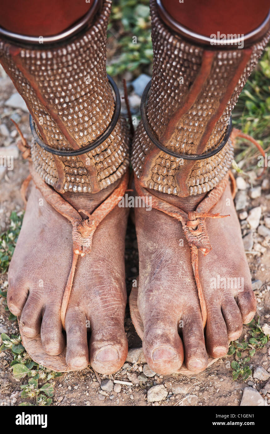 sandals worn by Himba woman in traditional dress who live in the Kunene Region, Namibia - Stock Image
