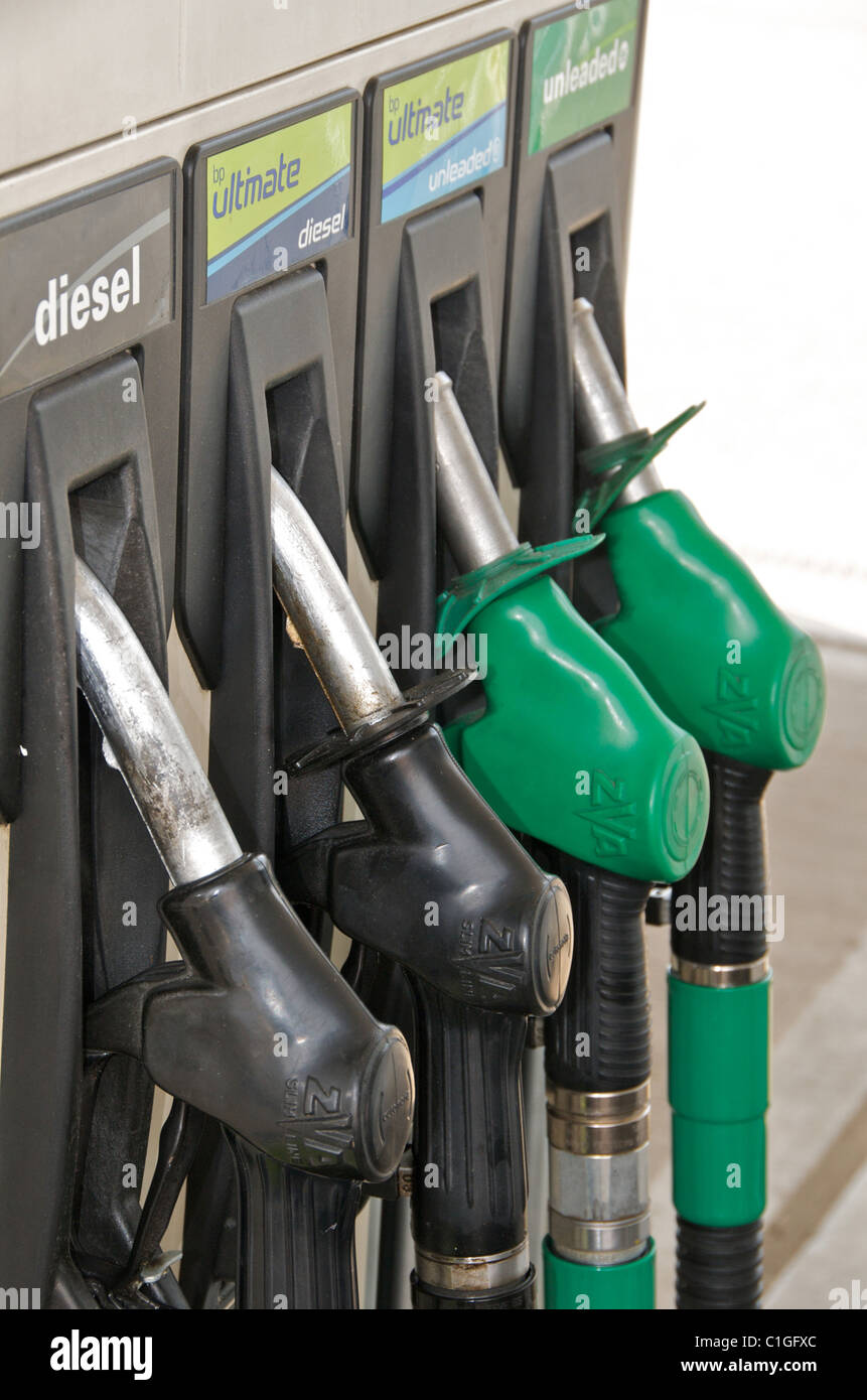 Images of fuel petrol diesel pumps nozzles on forecourt of garage filling station in UK - Stock Image