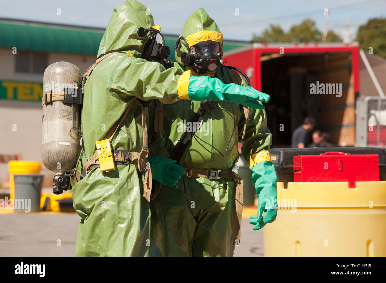 HazMat firefighters standing together - Stock Image