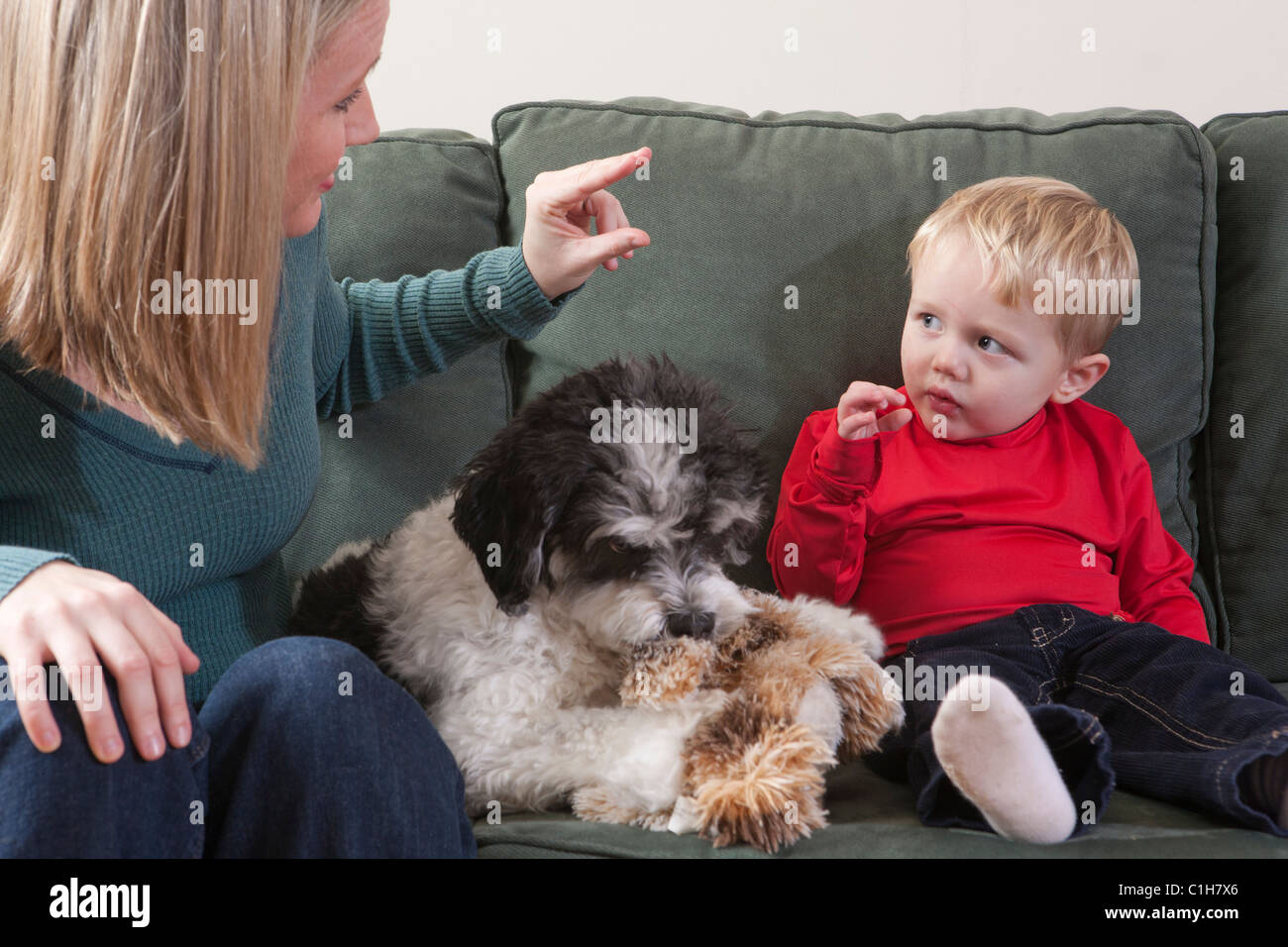 Woman signing the word 'No' in American Sign Language while communicating with her son - Stock Image
