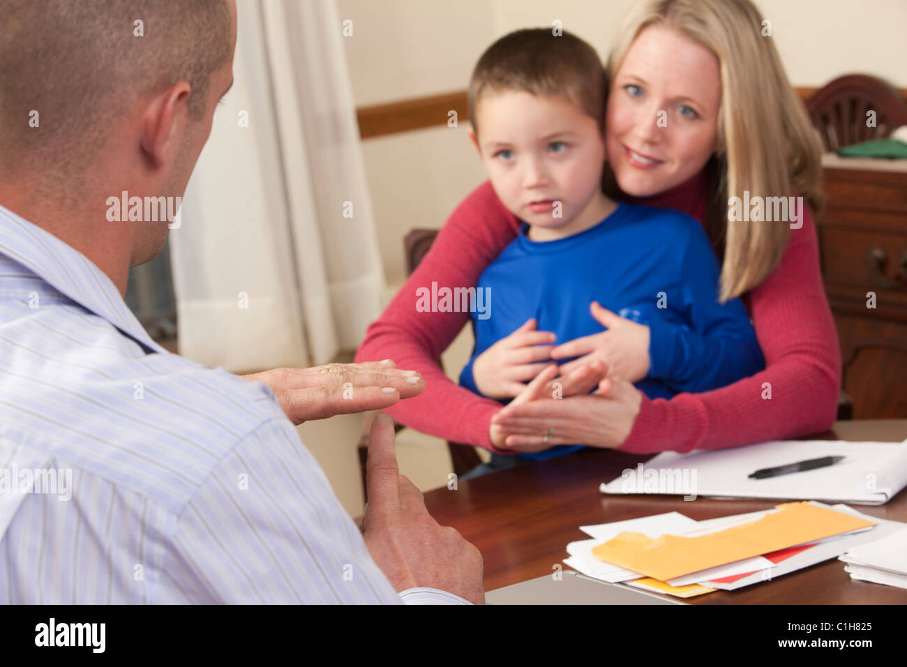 Woman signing the word 'Kindergarten/Nice' in American Sign Language while communicating with a man - Stock Image