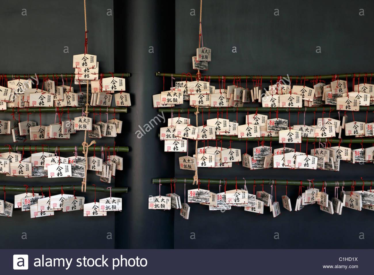 Good luck prayer tablets called Ema at the Yushima Seido temple, Tokyo, Japan - Stock Image