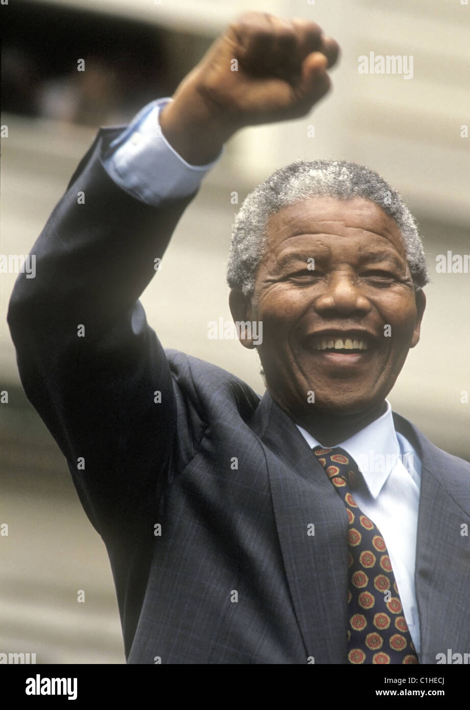 Nelson Mandela raises his fist to salute the crowd after delivering a speech to a rally, during his visit in New - Stock Image