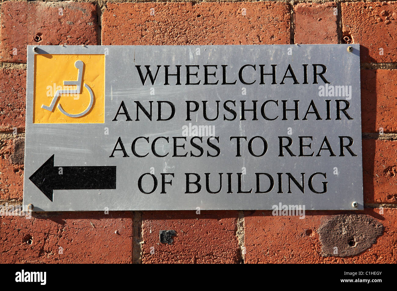 Disabled access sign on a building in a U.K. city. - Stock Image
