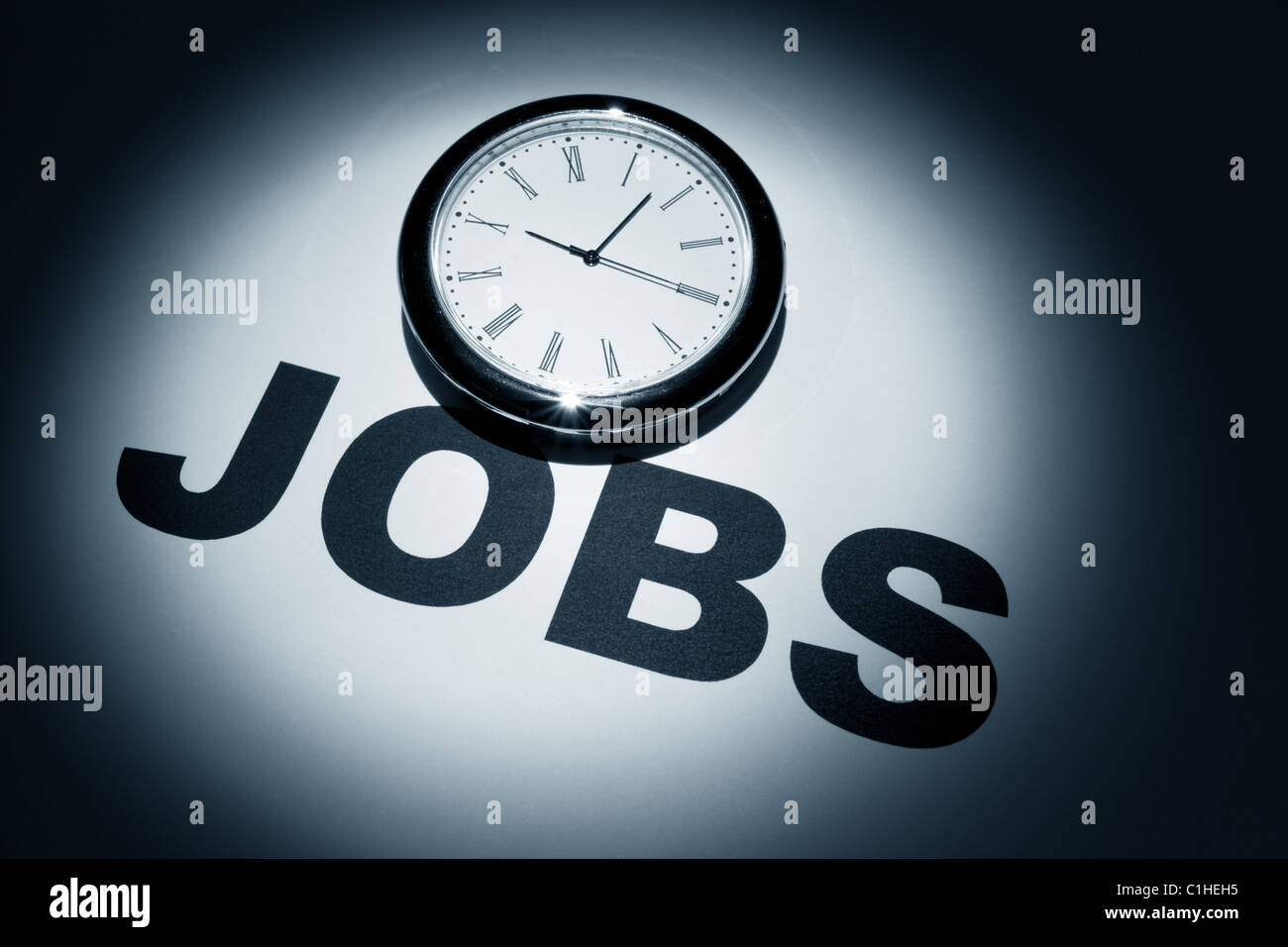 Clock and word of Jobs for background - Stock Image