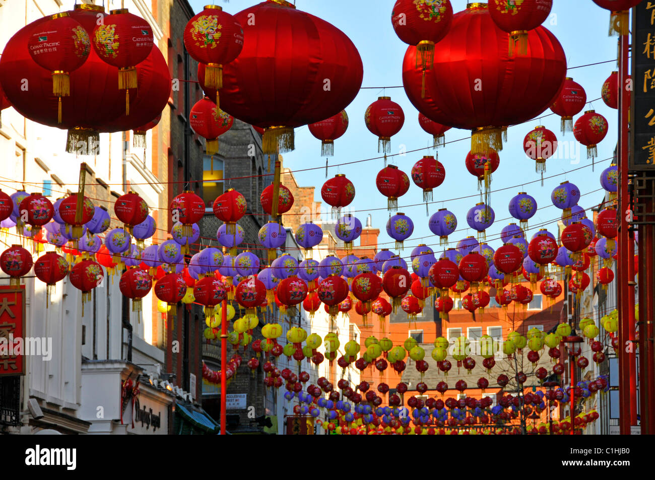 London West End street scene close up of colourful lantern decorations above China Town Gerrard Street England UK - Stock Image