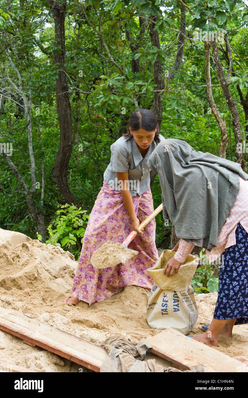 Burmese girls labouring on building site near Taung Kalat , Mount Popa, Myanmar - Stock Image
