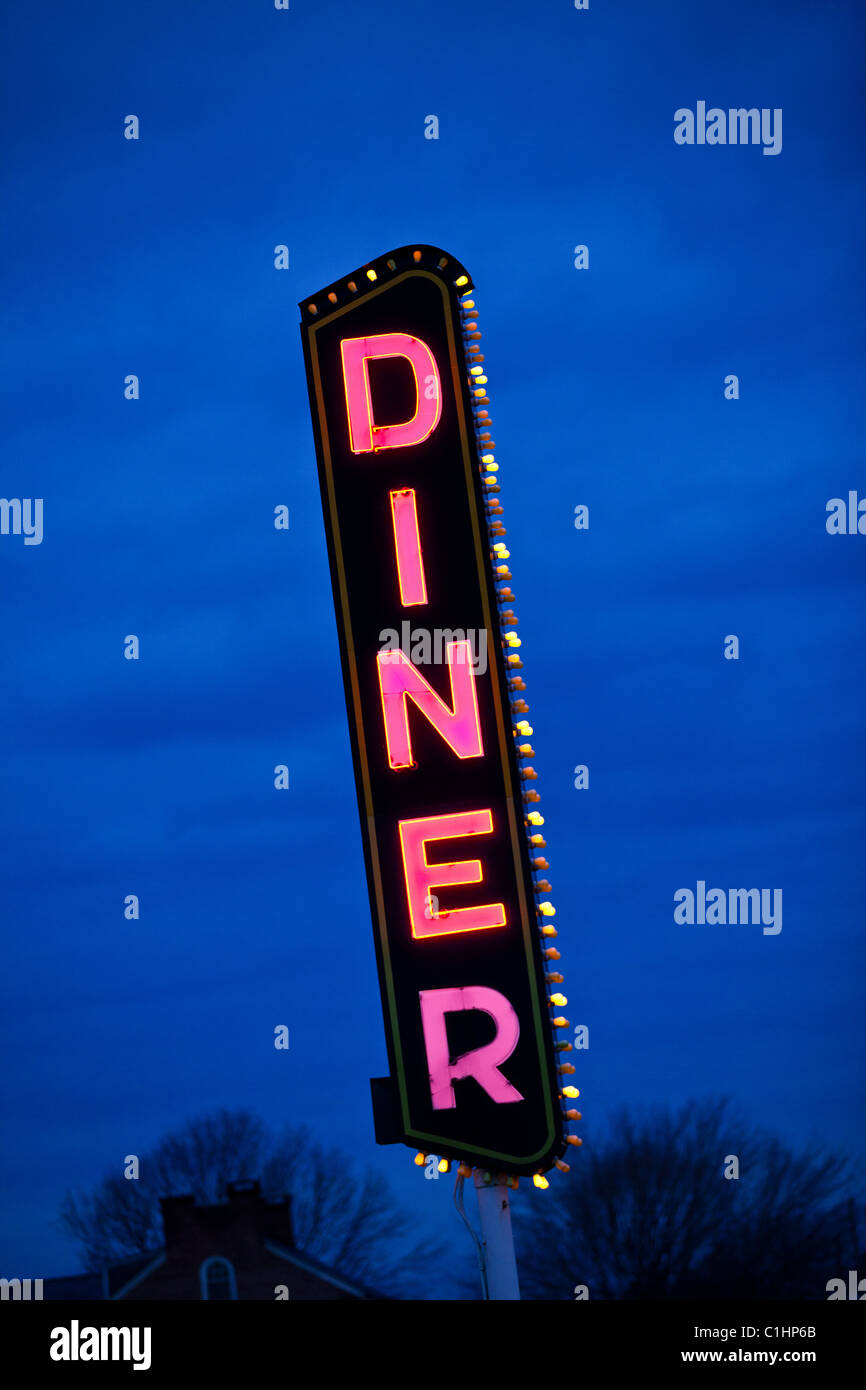 Neon diner sign against a blue sky in Gordonville, PA. - Stock Image