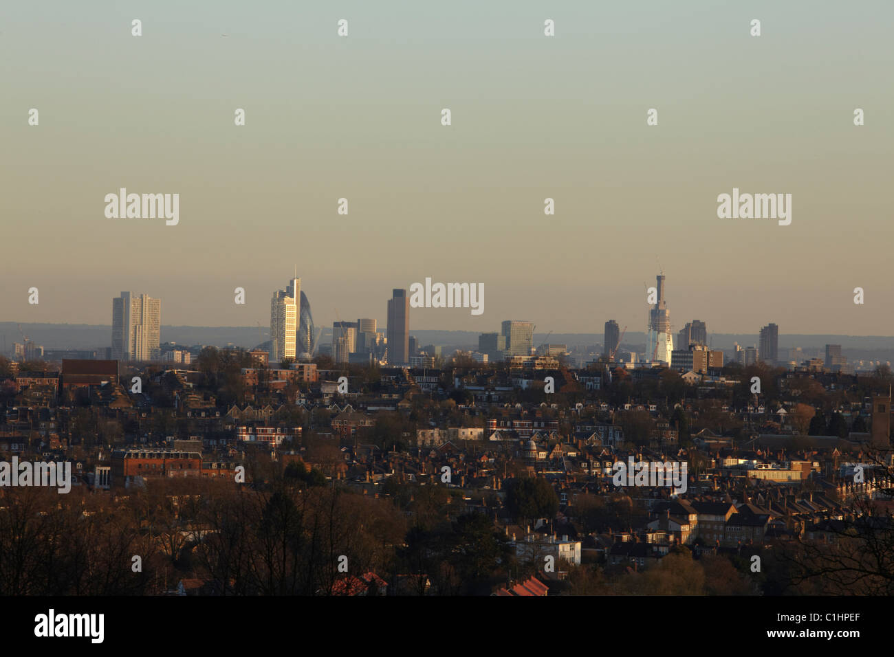 London skyline seen from Alexandra palace with the warm glow of sunset - Stock Image