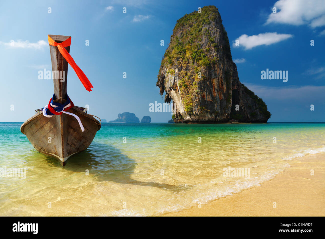 Tropical beach, long tail boat, Andaman Sea, Thailand - Stock Image