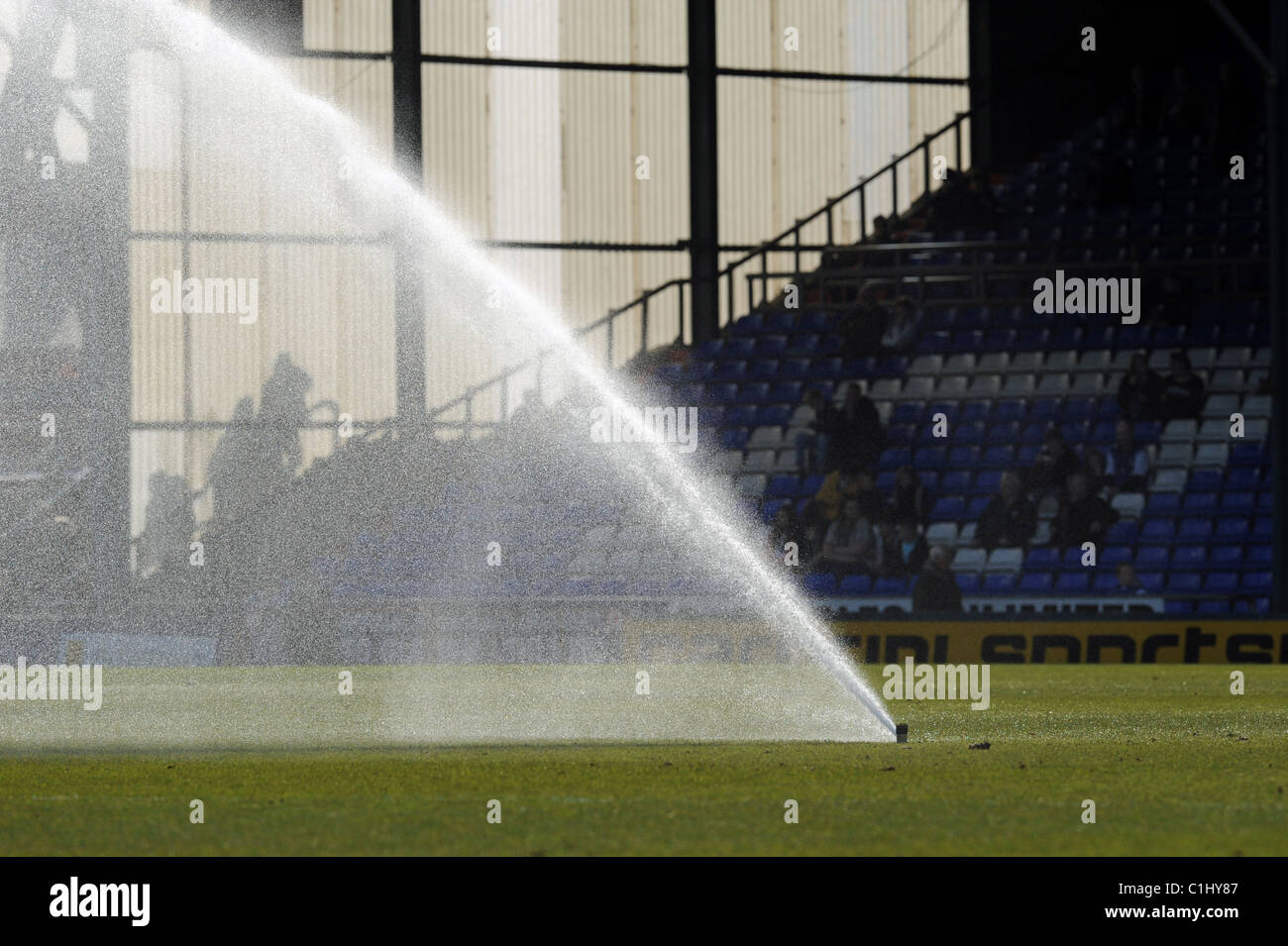 Water sprinkler on a football pitch UK - Stock Image