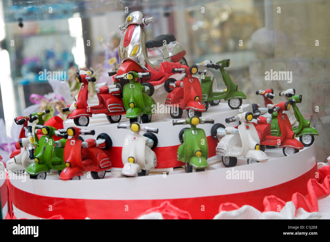 vespa scooter cake in shop window, turin, italy - Stock Image