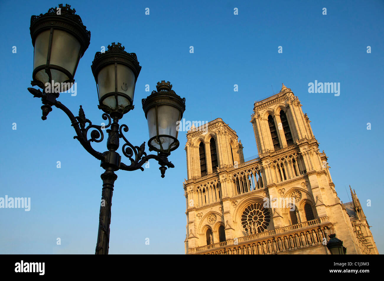An art deco streetlamp outside the Notre Dame cathedral in Paris. - Stock Image